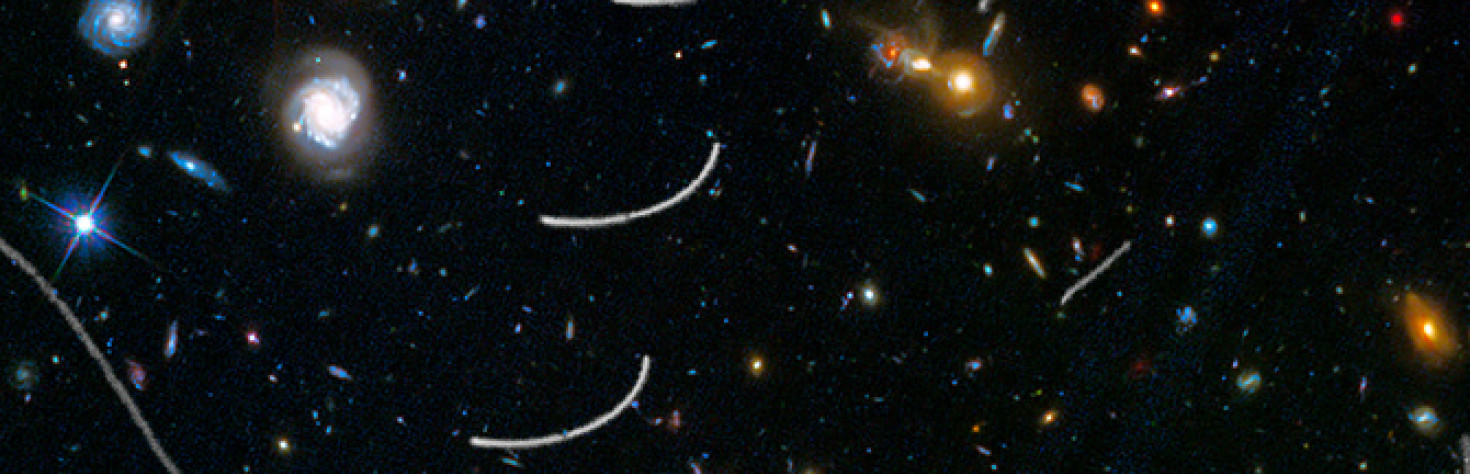 HubbleSite: News - Hubble Sees Nearby Asteroids Photobombing Distant Galaxies