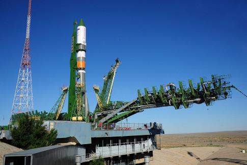 Cargo Ship Ready for Launch as Robotic Arm Unloads Dragon...