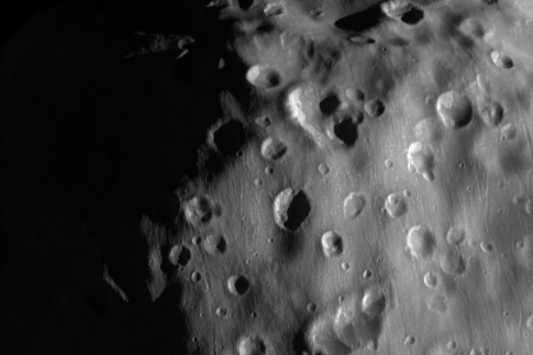 Saturn`s `Potato` Moon Epimetheus Bears Scars of Past Collisions...