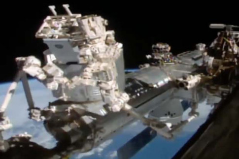 Space Station Robot Installs Neutron Star Explorer: Watch the...