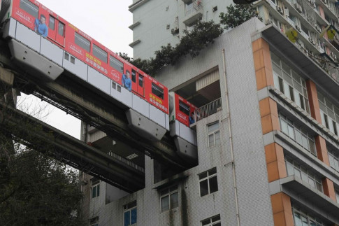 There's no need to walk to the train, if you live in this building. It comes to you.