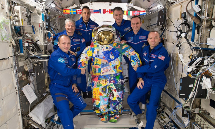 Astronauts Take on Science, Plumbing and Cargo Duties Today