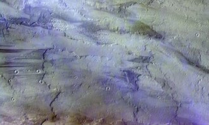 Clouds over lava flows on Mars