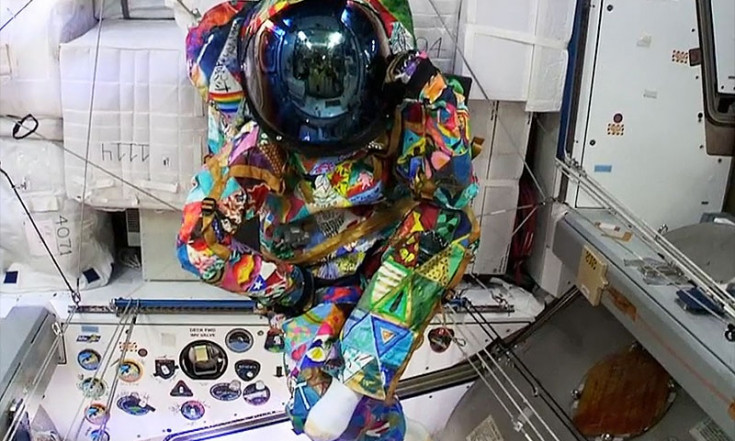 Colorful spacesuit painted by children with cancer worn by...