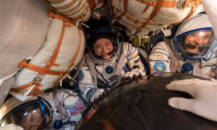 Safe Soyuz Touchdown at Sunrise Returns U.S.-Russian Crew after...