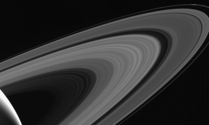 Saturn Moon Tethys Shines Above Rings in Gorgeous Photo
