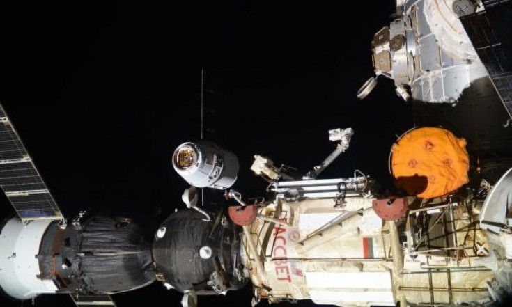 Science-Laden Dragon Arrives at Space Station after Flawless...