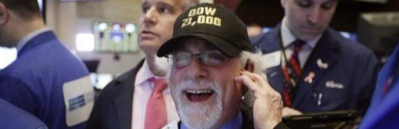 Dow crosses 21,000-point mark for the first time